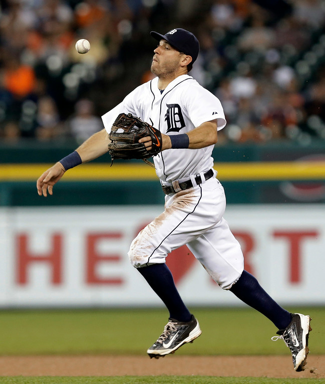. Detroit Tigers second baseman Ian Kinsler loses control of the ball on a New York Yankees\' Derek Jeter ground ball in the eighth inning of a baseball game in Detroit Tuesday, Aug. 26, 2014. (AP Photo/Paul Sancya)
