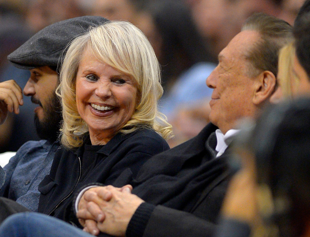 . Los Angeles Clippers owner Donald T. Sterling, right, sits with his wife Rochelle during the first half of the Clippers\' NBA basketball game against the Houston Rockets, Wednesday, Feb. 13, 2013, in Los Angeles. (AP Photo/Mark J. Terrill)
