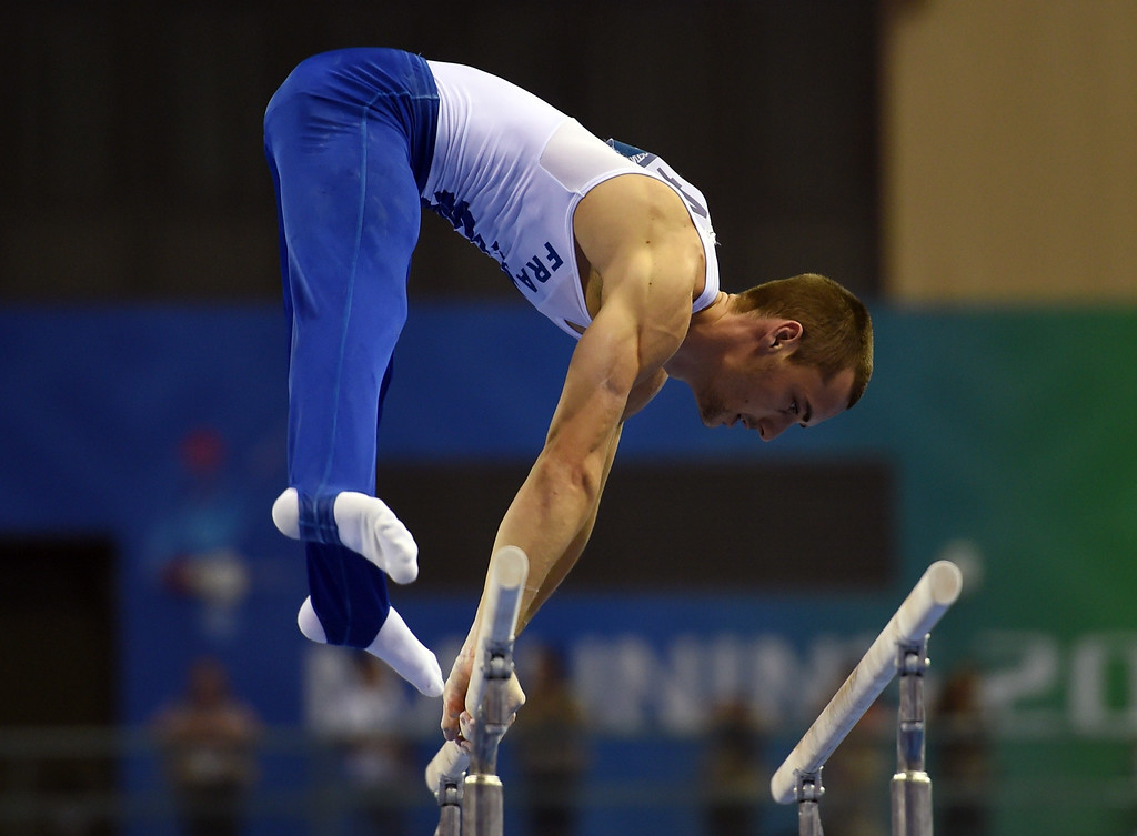 . Cyril Tommasone of France competes on the parallel bars during the men\'s qualification at the Gymnastics World Championships in Nanning, in China\'s southern Guangxi province on October 4, 2014. GREG BAKER/AFP/Getty Images