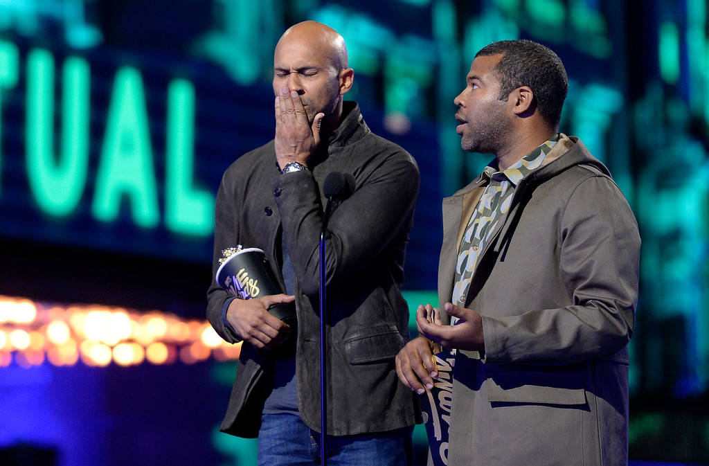 . Keegan-Michael Key, left, and Jordan Peele present the award for best virtual performance at the MTV Movie Awards at Warner Bros. Studio on Saturday, April 9, 2016, in Burbank, Calif. (Kevork Djansezian/Pool Photo via AP)