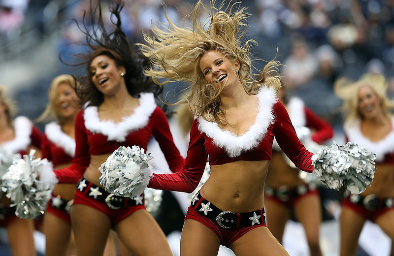 . The Dallas Cowboys Cheerleaders perform as the Dallas Cowboys take on the New Orleans Saints at Cowboys Stadium on December 23, 2012 in Arlington, Texas.  (Photo by Tom Pennington/Getty Images)