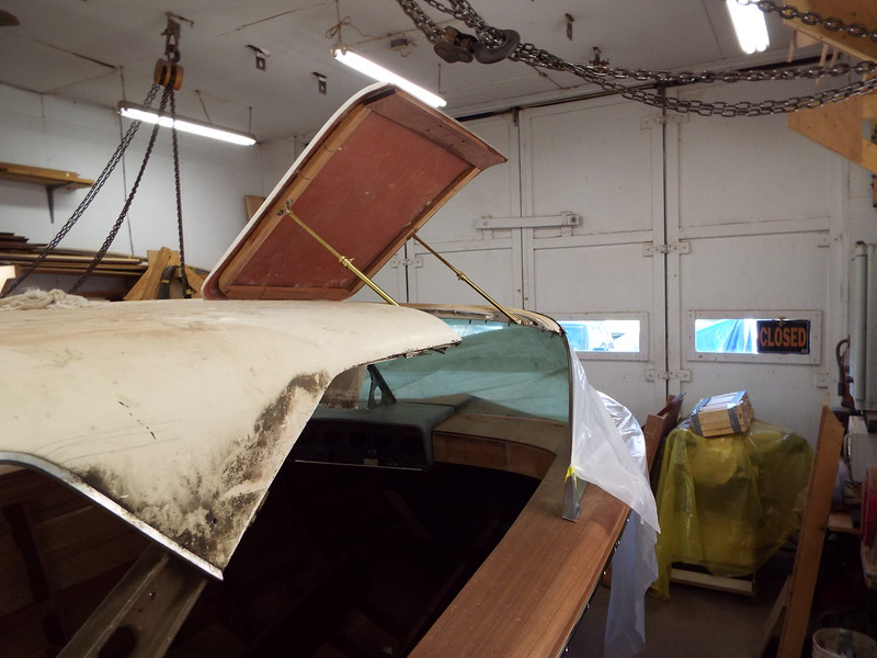 Starboard gull wing held open with the new door supports.