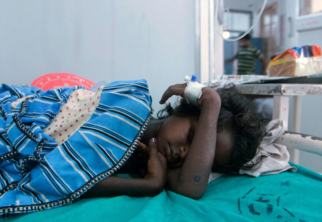 . A sick child rests at a hospital after consuming contaminated school meals in the eastern Indian city of Patna July 17, 2013. At least 22 children died and dozens were taken to hospital with apparent food poisoning after eating a meal provided for free at their school in the Indian state of Bihar, officials said on Wednesday, sparking violent protests. REUTERS/Stringer