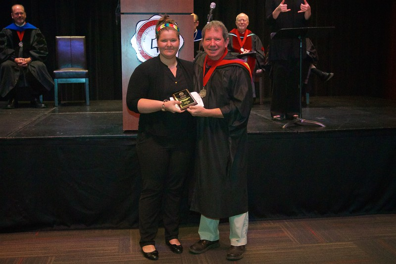 THE AMERICAN SIGN LANGUAGE AWARD -Is given to a senior who has demonstrated excellence in the field of American Sign Language. The recipient is Rose Marie Hooton.