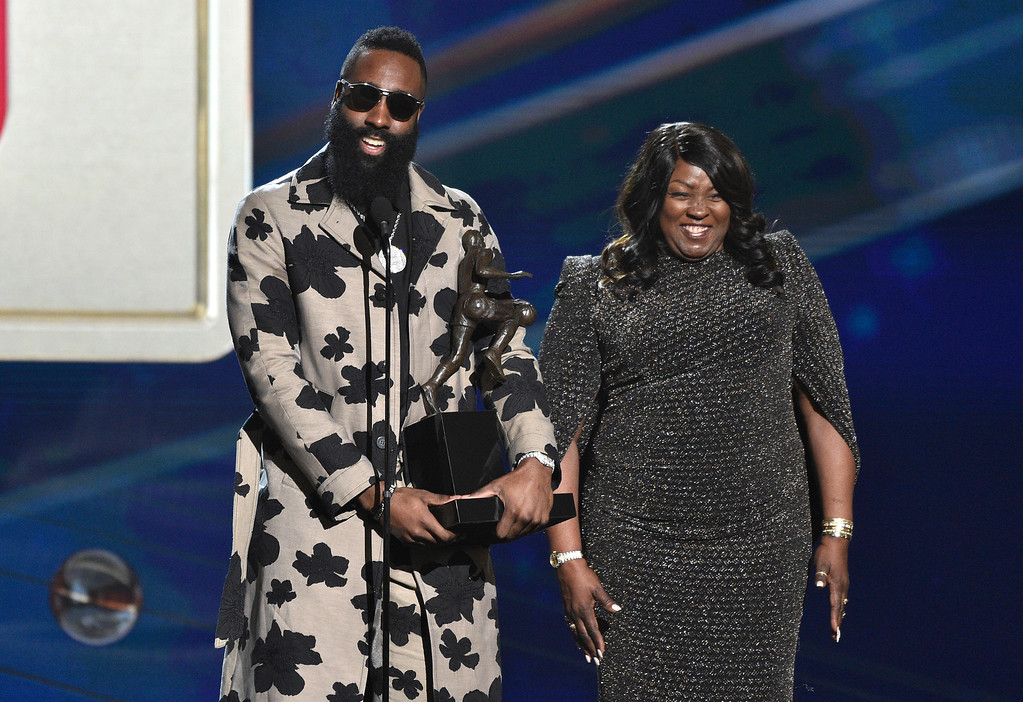 . CORRECTS SPELLING OF LAST NAME TO HARDEN, INSTEAD OF HARDIN - NBA player James Harden, of the Houston Rockets, left, accepts the most valuable player award as his mother, Monja Willis, looks on at the NBA Awards on Monday, June 25, 2018, at the Barker Hangar in Santa Monica, Calif. (Photo by Chris Pizzello/Invision/AP)