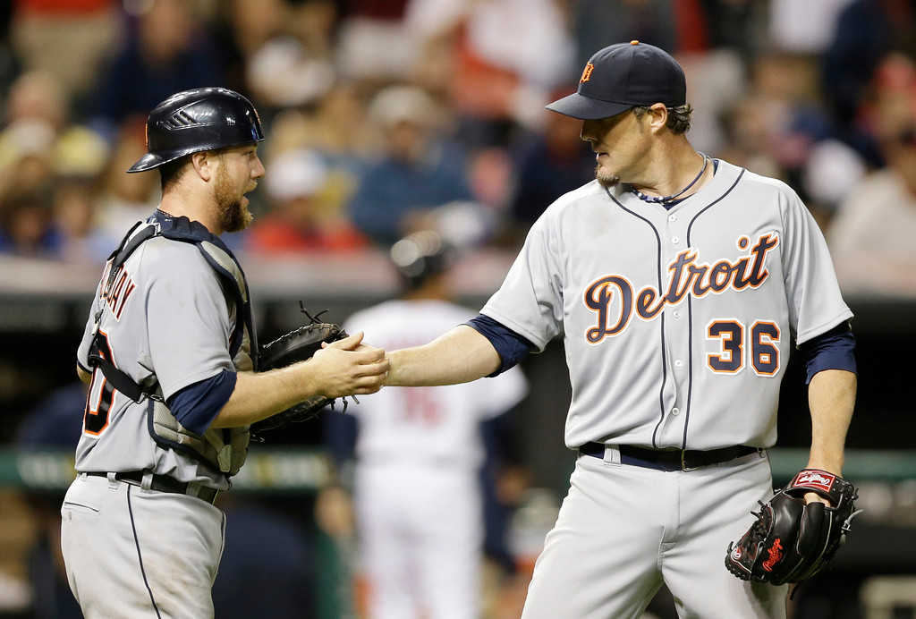 . Detroit Tigers relief pitcher Joe Nathan, right, is congratulated by teammate Bryan Holaday after they defeated the Cleveland Indians 6-4 in a baseball game on Friday, June 20, 2014, in Cleveland. (AP Photo/Tony Dejak)