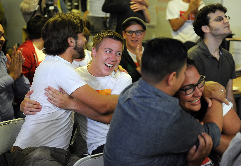 . Scott Gizicki, 24-years-old, and Alex Masterson, 24-years-old hug as they celebrate at Equality California in West Hollywood after the Supreme Court struck down the Defense of Marriage Act Wednesday, June 26, 2013. Equality California is the largest lesbian, gay, bisexual and transgender rights organization in California. (Hans Gutknecht/Los Angeles Daily News)