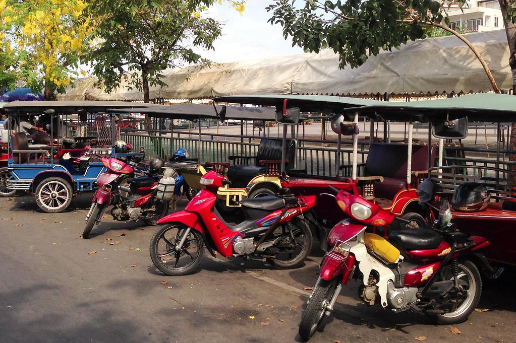 Tuk Tuk's Await Passengers in Phnom Penh, Cambodia