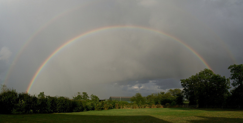 29 July 2013. The same great 180 double rainbow but natural with no filter. This is two landscape images stitched for the pano. Captured with Oly OM-D & 12mm,  f5 1/11250s