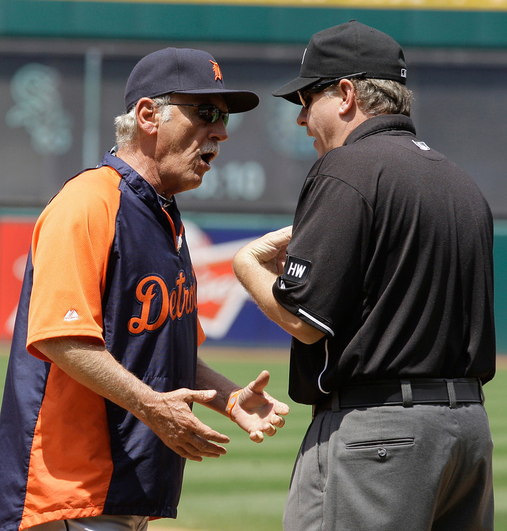 . Detroit Tigers manager Jim Leyland, left, argues with first base umpire Paul Emmel after Leyland was ejected in the fifth inning of a baseball game against the Cleveland Indians, Thursday, May 24, 2012, in Cleveland. (AP Photo/Tony Dejak)