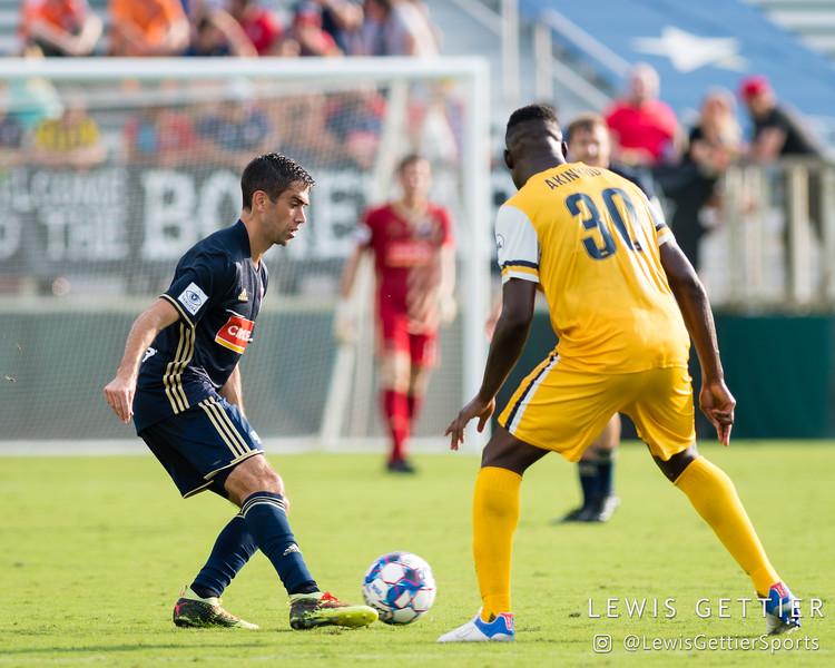 North Carolina FC midfielder Austin da Luz (6) and Nashville SC midfielder Bolu Akinyode (30)