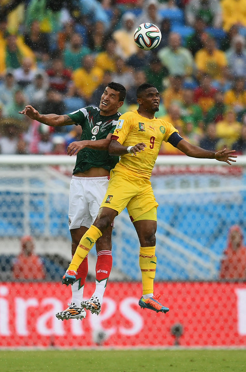 . Francisco Javier Rodriguez of Mexico and Samuel Eto\'o of Cameroon go up for a head ball in the first half during the 2014 FIFA World Cup Brazil Group A match between Mexico and Cameroon at Estadio das Dunas on June 13, 2014 in Natal, Brazil.  (Photo by Matthias Hangst/Getty Images)