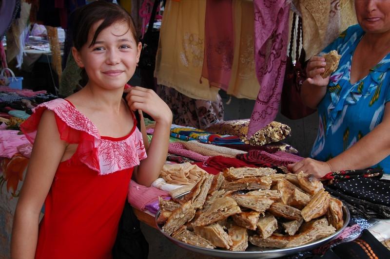 Uzbek Girl Selling Sweets - Khiva, Uzbekistan