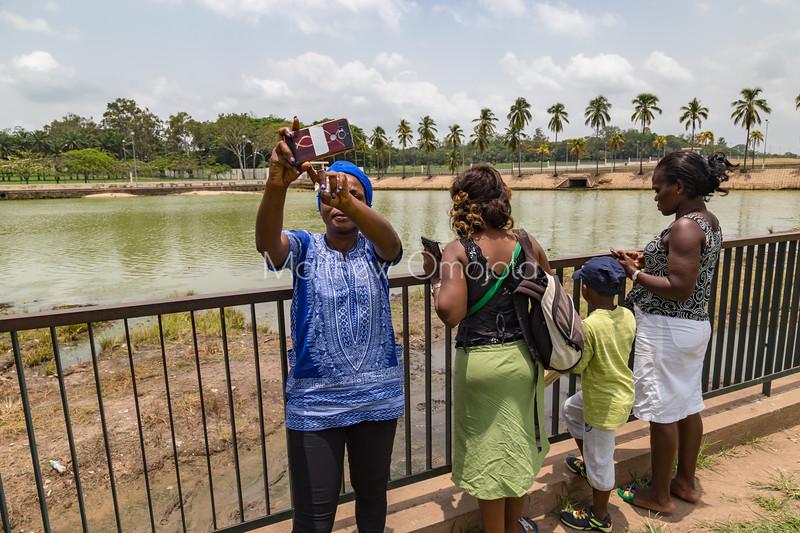 Visitors at the crocodile lake President palace Yamoussoukro taking selfie.
