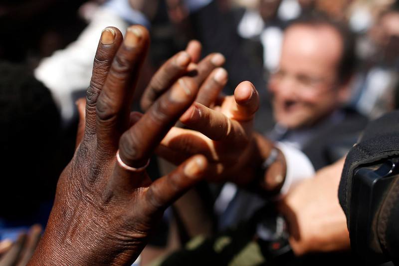 """. France\'s President Francois Hollande greets people in the center of Timbuktu February 2, 2013. Malians chanting \""""Thank you, France!\"""" mobbed Hollande on Saturday as he visited the desert city of Timbuktu, retaken from Islamist rebels, and pledged France\'s sustained support for Mali to expel jihadists. REUTERS/Benoit Tessier"""