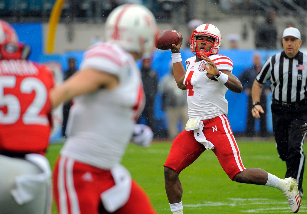 . Nebraska quarterback Tommy Armstrong Jr. (4) passes the ball during the first half of the Gator Bowl NCAA college football game against Georgia, Wednesday, Jan. 1, 2014, in Jacksonville, Fla. (AP Photo/Stephen B. Morton)
