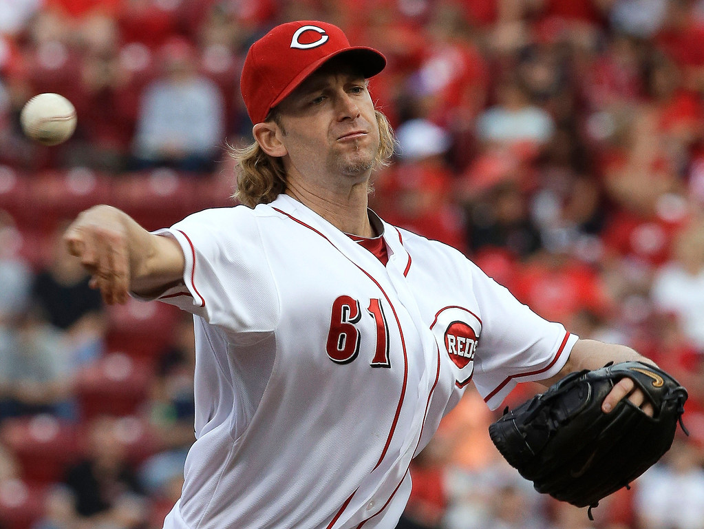 . Cincinnati Reds starting pitcher Bronson Arroyo throws to a Colorado Rockies batter in the first inning of a baseball game, Monday, June 3, 2013, in Cincinnati. (AP Photo/Al Behrman)