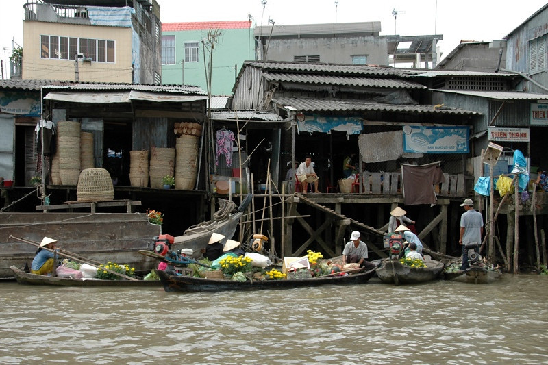 Boats and Houses on Stilts - Mekong Delta, Vietnam