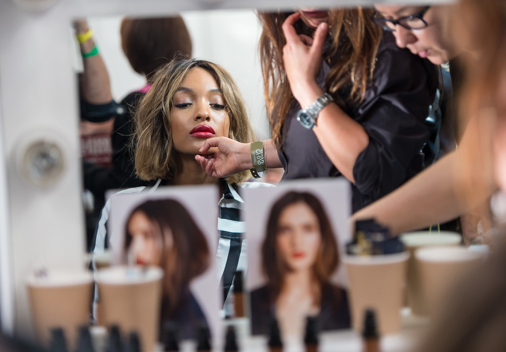 . Jourdan Dunn prepares backstage at the Burberry Prorsum show during London Fashion Week Spring Summer 2015 on September 15, 2014 in London, England.  (Photo by Ian Gavan/Getty Images)