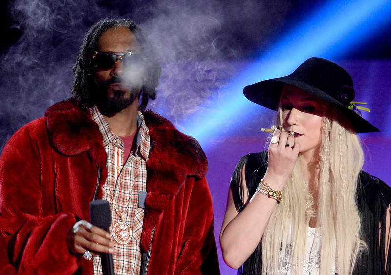 . Rapper Snoop Dogg and singer Ke$ha speak onstage during the 2013 MTV Movie Awards at Sony Pictures Studios on April 14, 2013 in Culver City, California.  (Photo by Kevork Djansezian/Getty Images)