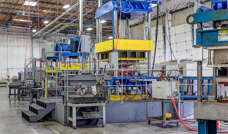 Large manufacturing facility with heavy equipment.