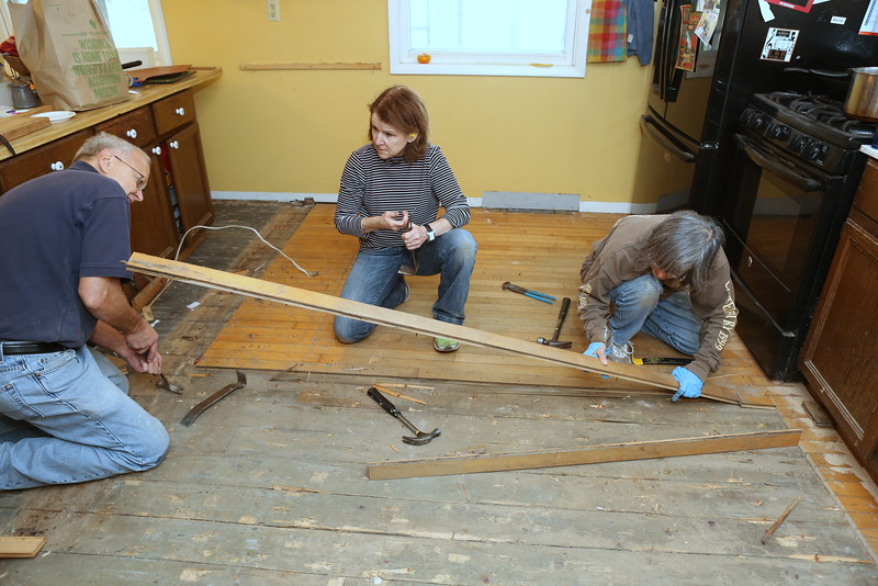 Volunteers from MMC reclaim maple flooring from the current house