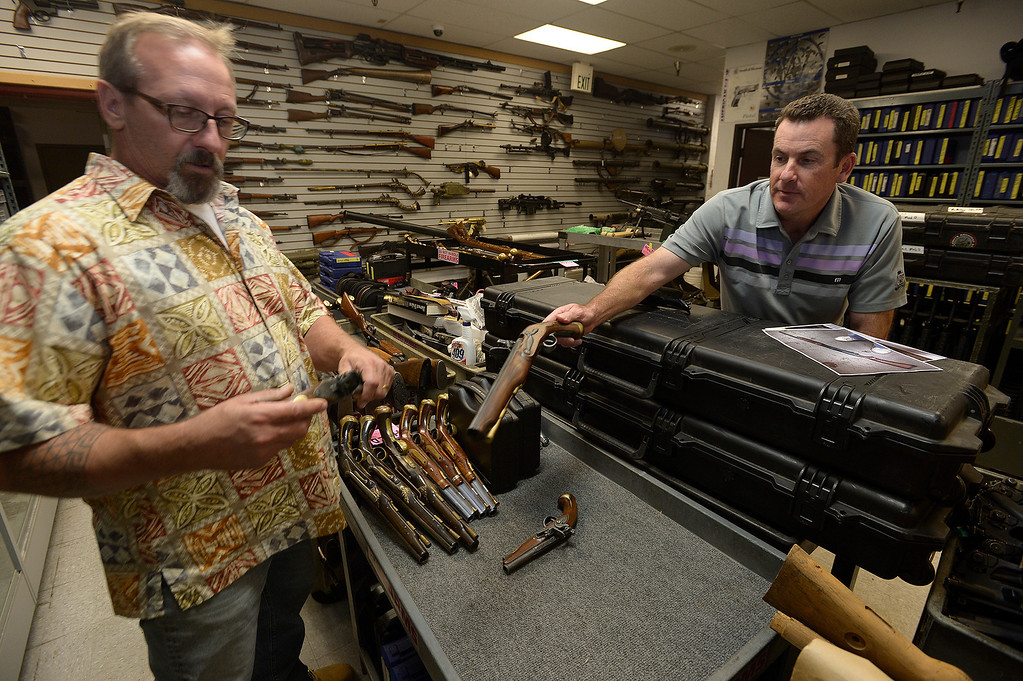 . (l-r) Rick Caprarelli and Gregg Bilson, Jr. look at fake guns. Bilson is the CEO of ISS Independent Studio Services, a prop house that holds hundreds of thousands of items used for motion pictures and television production. Runaway production has an impact on his business. Sunland, CA 12-31-2013. photo by (John McCoy/Los Angeles Daily News)