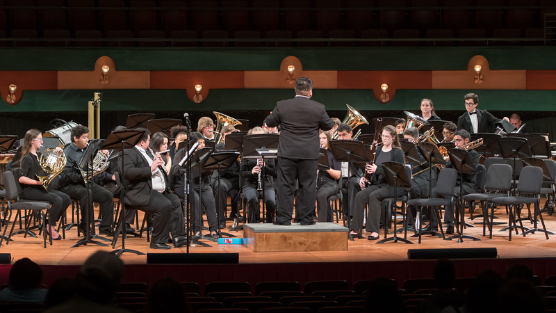 The University Symphonic Winds perform at the Performing Arts Center.
