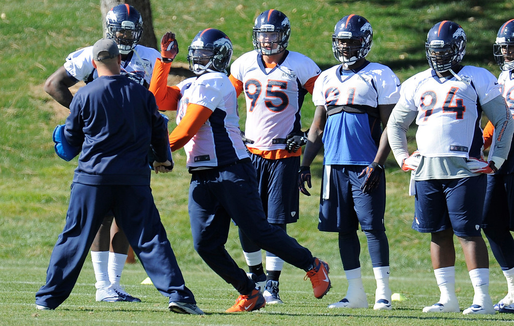 . Denver Broncos defensive end Shaun Phillips (90) was back at practice as he runs through drills October 24, 2013 at Dove Valley. (Photo by John Leyba/The Denver Post)