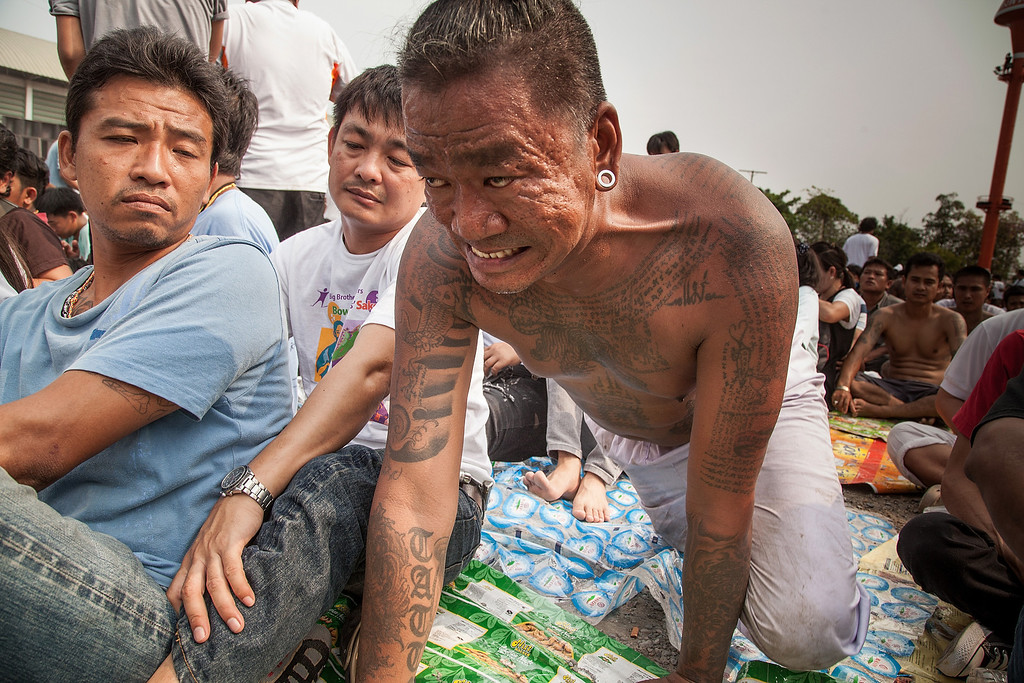 . A tattooed Thai devotee reportedly possessed by spirits crawls as he tries to pay his respect to a statue of Lord Buddha during the celebration of the annual Tattoo festival at Wat Bang Phra on March 15, 2014 in Nakhon Pathom, Thailand.  (Photo by Omar Havana/Getty Images)