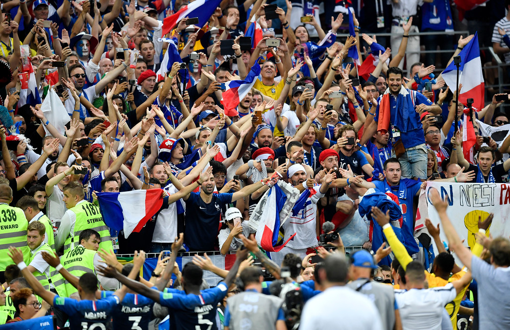 . The French team celebrate with their fans after winning 4-2 during the final match between France and Croatia at the 2018 soccer World Cup in the Luzhniki Stadium in Moscow, Russia, Sunday, July 15, 2018. (AP Photo/Martin Meissner)
