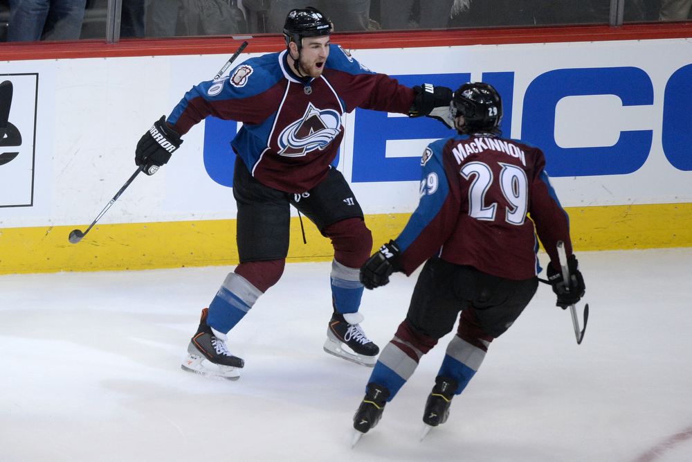 . Ryan O\'Reilly (90) of the Colorado Avalanche celebrates his goal on an assist from Nathan MacKinnon (29) against the Minnesota Wild during the second period of action. The Colorado Avalanche hosted the Minnesota Wild in the first round of the NHL playoffs at the Pepsi Center on Thursday, April 17, 2014. (Photo by Karl Gehring/The Denver Post)