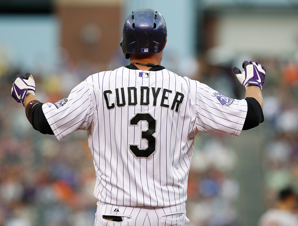 . Colorado Rockies\' Michael Cuddyer reacts after his RBI-single against the San Francisco Giants in the first inning of a baseball game in Denver on Saturday, June 29, 2013. Cuddyer extended his hitting streak to 26 games with the RBI single. (AP Photo/David Zalubowski)