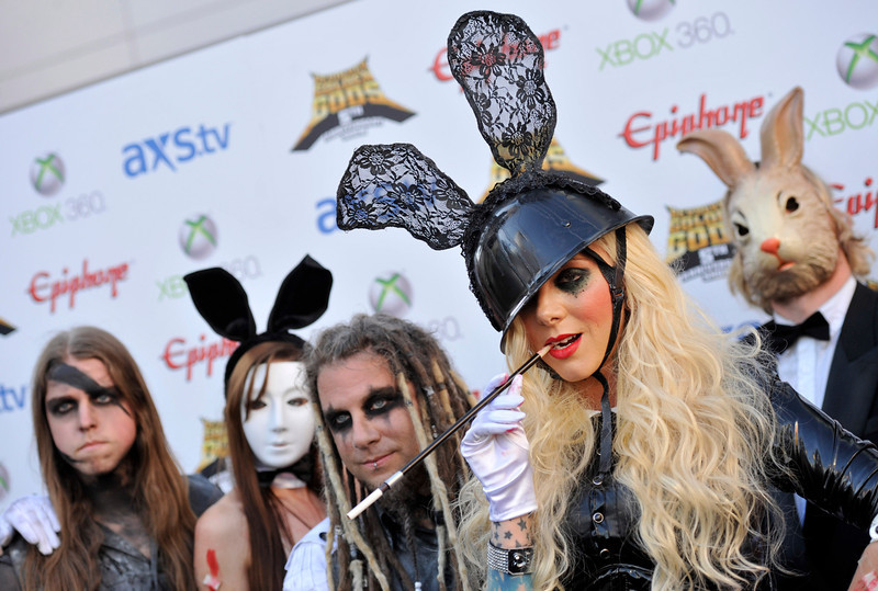 . Maria Brink of the rock band In This Moment poses with band members before the 2013 Revolver Golden Gods Award Show at Club Nokia on Thursday, May 2, 2013 in Los Angeles. (Photo by Chris Pizzello/Invision/AP)