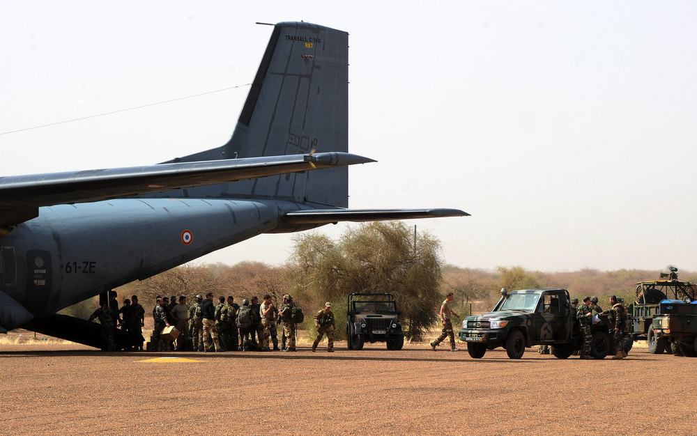 Description of . French army soldiers prepare to board on a French Transall plane on February 2, 2013 in Gao. French President Francois Hollande received a rapturous welcome as he visited Mali to push for African troops to take over a French-led offensive that drove back Islamist rebels from the country\'s desert north.  SIA KAMBOU/AFP/Getty Images