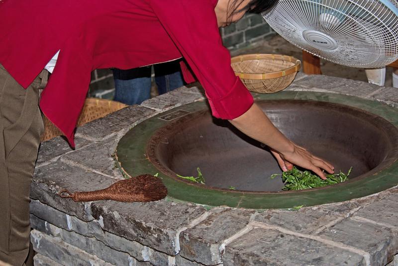 pan-frying fresh tea leaves, Guilin, China
