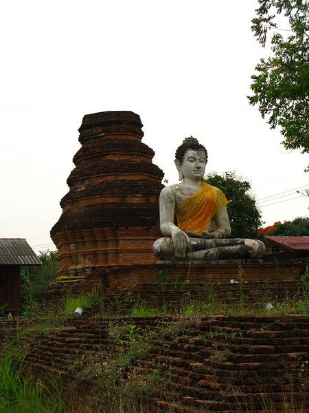 Buddha and old chedi in Chiang Saen