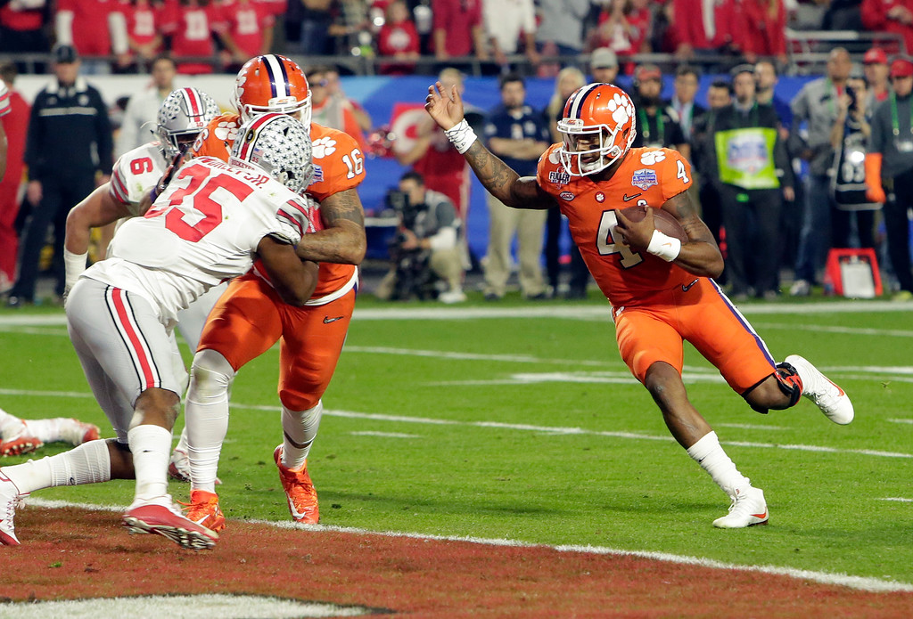 . Clemson quarterback Deshaun Watson (4) runs for a touchdown against Ohio State during the first half of the Fiesta Bowl NCAA college football game, Saturday, Dec. 31, 2016, in Glendale, Ariz. (AP Photo/Rick Scuteri)