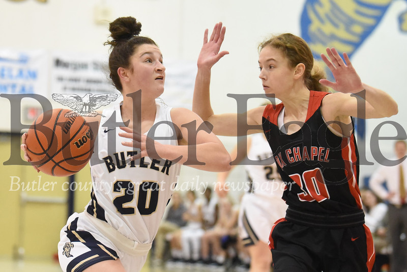 Butler's Emma Monteleone drives to the hoop against Fox Chapel's Clair Fenton in Thursday night's 56-51 home loss. Seb Foltz/Butler Eagle