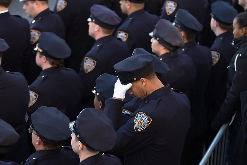 . Officers gathered outside the church following the funeral of slain NYPD officer Rafael Ramos at the Christ Tabernacle Church on December 27, 2014 in the Glenwood section of the Queens borough of New York City. Thousands of fellow officers, family, friends and Vice President Joseph Biden are expected at the church in the Glendale neighborhood of Queens for the funeral. (Photo by Kevin Hagen/Getty Images)