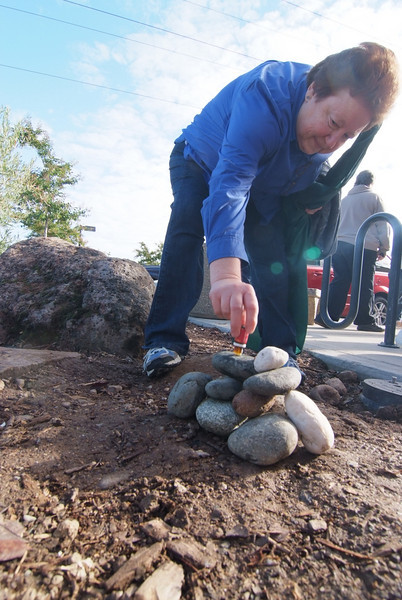 """Adding anointing oil to the memorial stones brought over from the old campus as we """"crossed over!"""""""