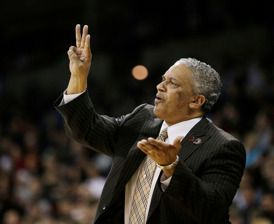 . New Mexico State coach Marvin Menzies talks to his players during the first half against San Diego State in a second-round game of the NCAA men\'s college basketball tournament in Spokane, Wash., Thursday, March 20, 2014. (AP Photo/Young Kwak)