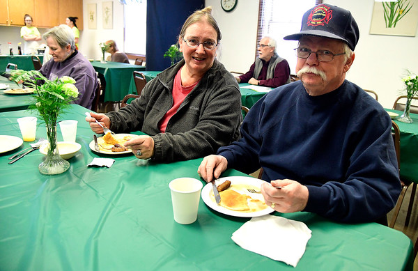 3/9/2019 Mike Orazzi | Staff Heidi and Gary Jameson enjoy pancakes during the Pancake Breakfast & Maple Sugaring program at the New Britain Youth Museum & Hungerford Nature Center on Saturday in Kensington.