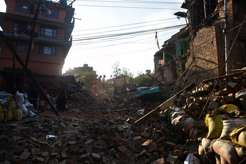 ". People walk through a neighborhood with collapsed houses in Bhaktapur, on the outskirts of Kathmandu, on April 27, 2015, two days after a 7.8 magnitude earthquake hit Nepal. Nepalis started fleeing their devastated capital on April 27 after an earthquake killed more than 3,800 people and toppled entire streets, as the United Nations prepared a ""massive\"" aid operation.  PRAKASH MATHEMA/AFP/Getty Images"