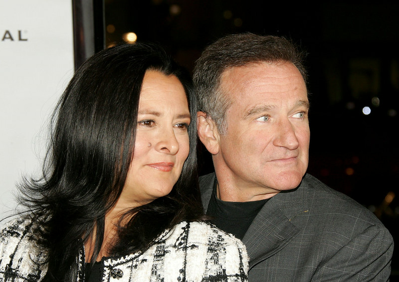 ". Actor Robin Williams (R) and wife Marsha Garces Williams (L) arrive at the premiere of Universal Pictures ""Man of the Year\"" at Grauman\'s Chinese Theatre October 4, 2006 in Hollywood, California.  (Photo by Frazer Harrison/Getty Images)"