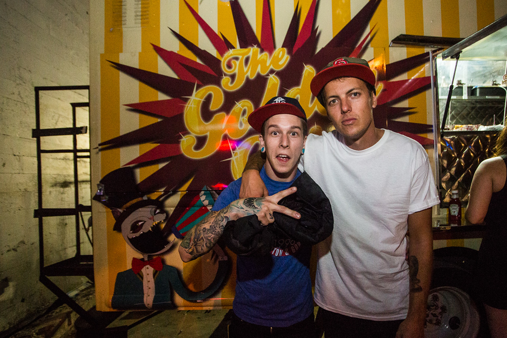 Justin of Sleeping With Sirens and Casey Ervin hanging out by the best food cart ever