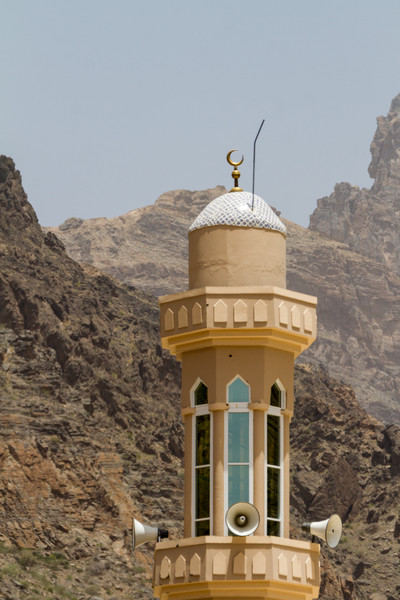Minaret with mountains in background - Oman