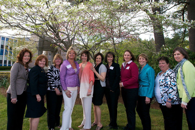 The Class of 1977 near the tree that they planted as students.