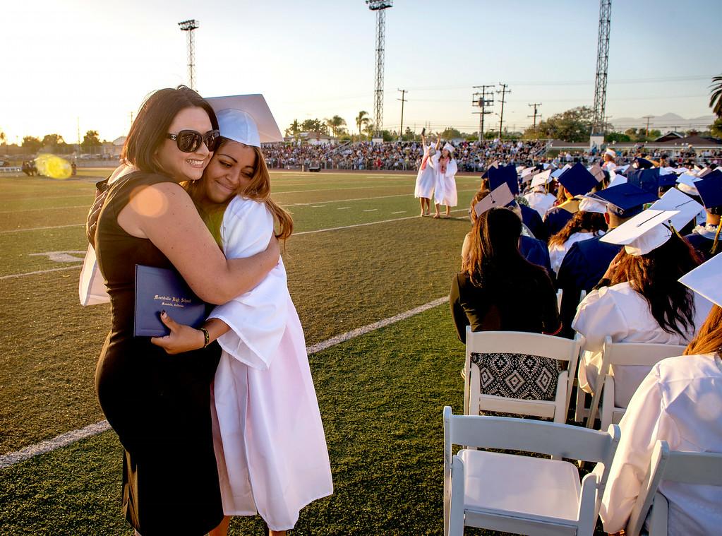 . Montebello High teacher Dayana (cq) Aguilar, left, hugs graduate Alyssa Soneff during commencement June 19, 2014.  (Staff photo by Leo Jarzomb/Whittier Daily News)