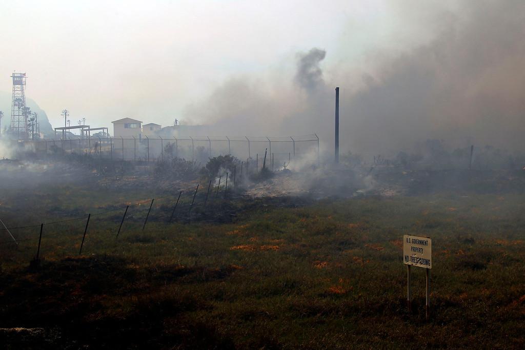 . A brush fire burns at a shooting range on the beach at Navel Base Ventura County  Friday, May 3, 2013.   (AP Photo/Nick Ut)